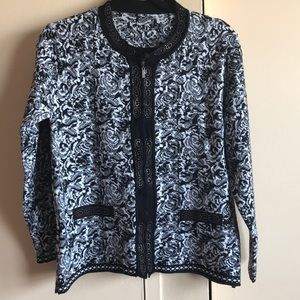 A zip up sweater with a pattern